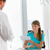 medical biller and coder working at a doctor's office